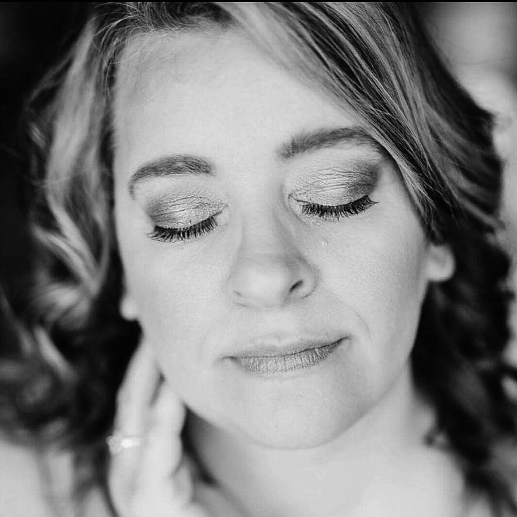 black and white picture of a relaxed woman with her eyes closed