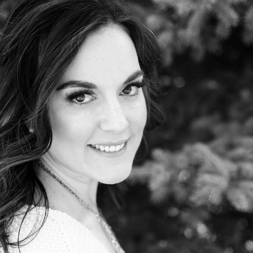 black and white image of Stephanie smiling