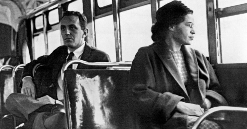 Black and white picture of Rosa Parks sitting on a bus